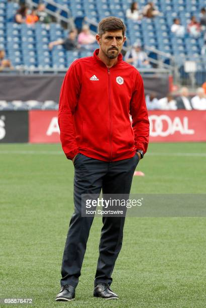Chicago Fire head coach Veljko Paunovic watches his players warm up before a regular season MLS match between the New England Revolution and the...
