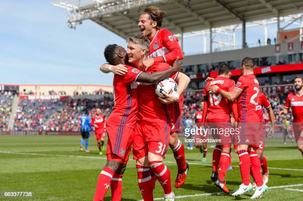 Chicago Fire midfielder Bastian Schweinsteiger celebrates scoring a goal in the first half with Chicago Fire forward David Accam and Chicago Fire...