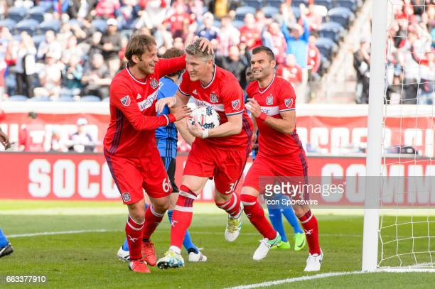 Chicago Fire midfielder Bastian Schweinsteiger celebrates scoring a goal in the first half during an MLS soccer match between the Montreal Impact and...