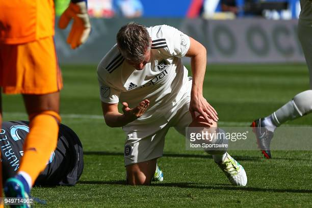 Chicago Fire midfielder Bastian Schweinsteiger collides with New York Red Bulls defender Michael Murillo and gets cut in his head during the first...