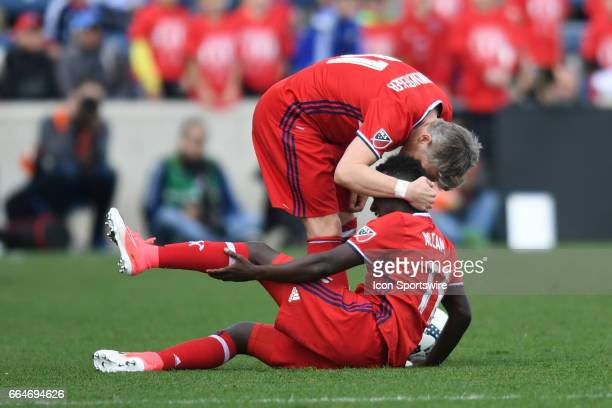 Chicago Fire midfielder Bastian Schweinsteiger comforts Chicago Fire forward David Accam during a game between the Montreal Impact and the Chicago...