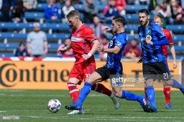 Chicago Fire midfielder Bastian Schweinsteiger dribbles the ball as Montreal Impact midfielder Adrian Arregui defends in the first half during an MLS...