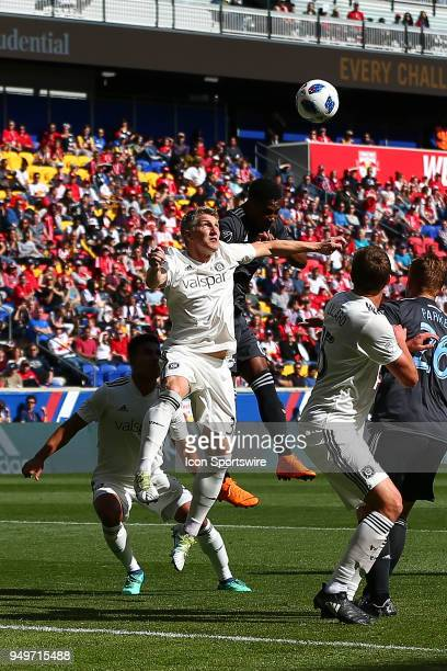 Chicago Fire midfielder Bastian Schweinsteiger goes up for a head ball during the first half of the Major League Soccer Game between the New York Red...