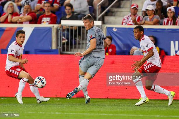 Chicago Fire midfielder Bastian Schweinsteiger passes the ball behind himself during the first half of the Major League Soccer game between the New...