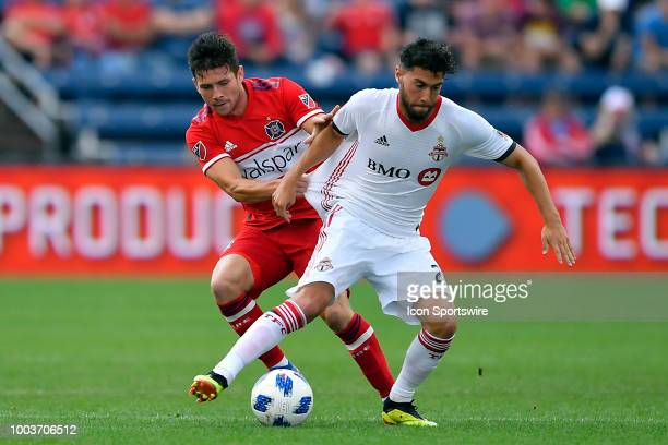 Chicago Fire midfielder Brandt Bronico and Toronto FC midfielder Jonathan Osorio battle for the ball on July 21 2018 at Toyota Park in Bridgeview...