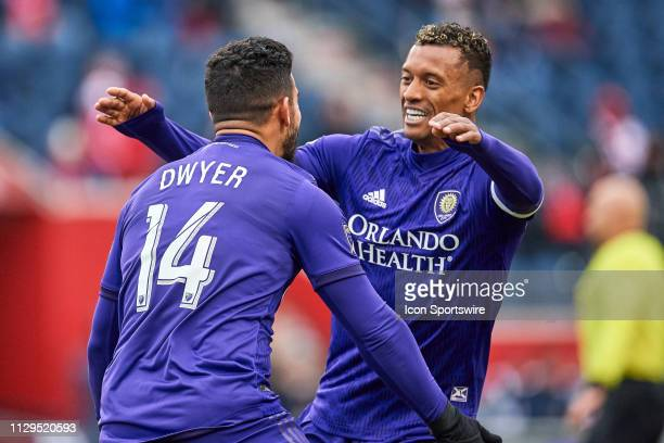 Chicago Fire midfielder Djordje Mihailovic celebrates with Orlando City forward Nani after scoring a goal in action during a MLS match between the...