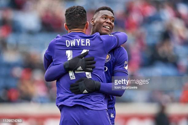 Chicago Fire midfielder Djordje Mihailovic celebrates with Orlando City defender Kamal Miller after scoring a goal in action during a MLS match...