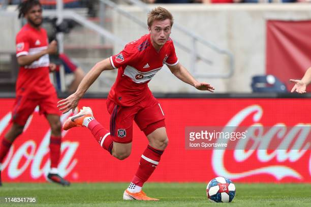 Chicago Fire midfielder Djordje Mihailovic dribbles the ball in game action during a MLS match between the Chicago Fire and New York City on May 25...
