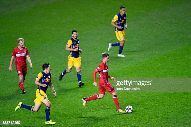 Chicago Fire midfielder Djordje Mihailovic dribbles with the ball during the MLS Cup Playoff match between the New York Red Bulls and the Chicago...