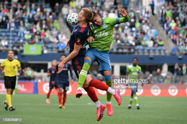 Chicago Fire Robert Beric and Zavier Arreaga go up for a header during a MLS match between the Chicago Fire and the Seattle Sounders at Century Link...