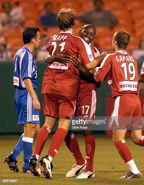 Chicago Fire teammates Justin Mapp Dipsy Selolwane and Craig Capano celebrate the game tieing score by teammate Ante Razov while Kerry Zavagnin of...