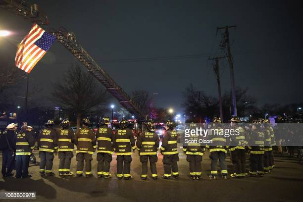 Chicago firefighters and police officers line up outside of the Cook County Medical Examiner's office waiting for the remains of Chicago Police...