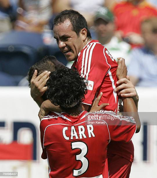 Chicago Fire's Calen Carr Cuauhtemoc Blanco right and Chad Barrett celebrate Blanco's goal during the first half of a soccer game at Toyota Park in...