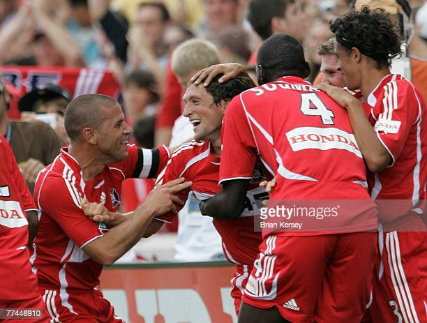 Chicago Fire's Chris Armas and Bakary Soumare celebrate with John Thorrington after Thorrington scored the winning goal during the second half of an...