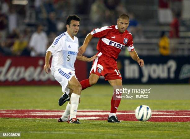Chicago Fire's Chris Armas and Kansas City Wizards' Kerry Zavagnin battle for the ball