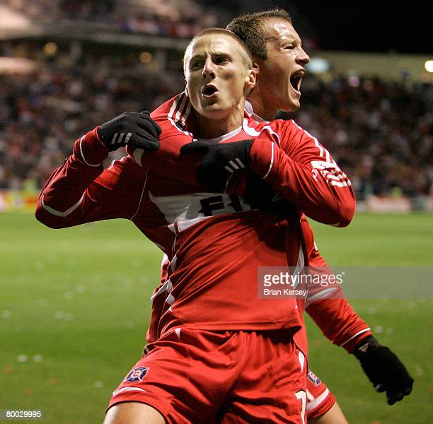 Chicago Fire's Chris Rolfe and Chad Barrett celebrate Rolfe's goal against DC United during the first half of game 1 of the Eastern Conference...