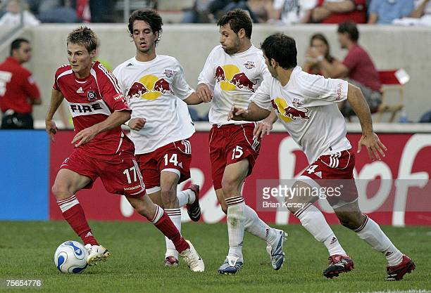 Chicago Fire's Chris Rolfe in action against the New York Red Bulls' Joe Vide Dema Kovalenko and Carlos Mendes at Toyota Park in Bridgeview Illinois...