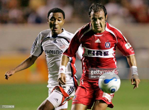 Chicago Fire's Cuauhtemoc Blanco and New England Revolution's James Riley go for the ball during the second half of an MLS soccer game at Toyota Park...