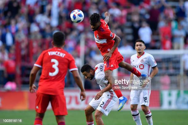 Chicago Fire's Raheem Edwards heads the ball over Toronto FC defender Justin Morrow on July 21 2018 at Toyota Park in Bridgeview Illinois