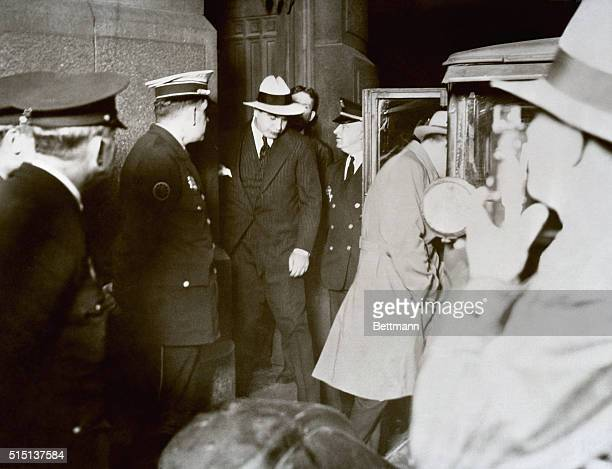 Chicago gang leader Al Capone leaving municipal court following Judge Walsh's dismissal of his petition for a parole Capone returned to the Eastern...