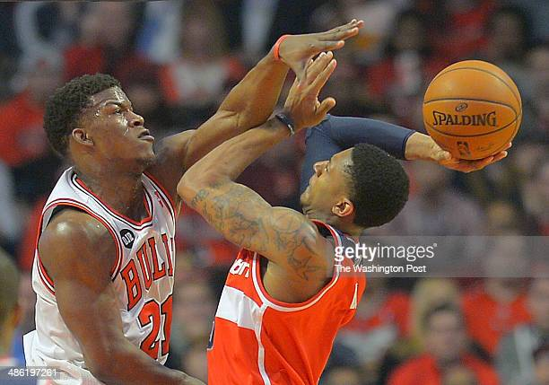 Chicago guard Jimmy Butler left fouls Washington guard Bradley Beal on a shooting attempt as the Washington Wizards play the Chicago Bulls in game 2...