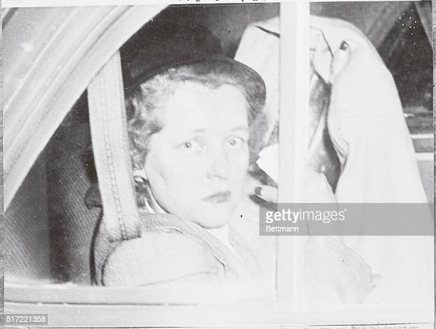Her face showing strain of interrogation WAC captain Kathleen Nash Durant whisked away in automobile after lie detector test here resulted in...