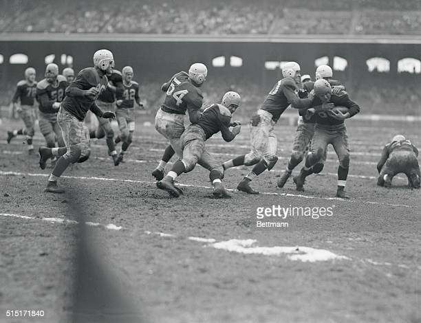 Herman Rohrig Packer half is tackled after grabbing a Card fumble and running ten yards in second quarter of CardinalsGreen Bay Packers game The...
