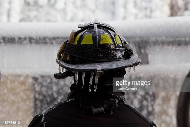 Chicago, IL -1/24/13- Icicles on the helmet of a Chicago firefighter during the fire at old Harris Marcus warehouse
