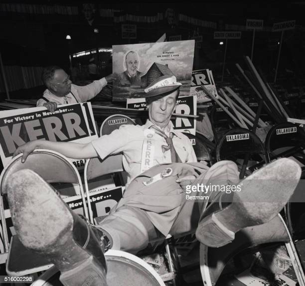 7/26/1952 Chicago IL All over but the snoring His weary 'dogs' propped up for comfort this tired Democratic delegate Marvin S Monfort of Alva OK...
