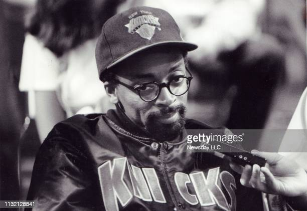 Director Spike Lee wears a New York Knicks cap and jacket at the Knicks vs Bulls basketball game in Chicago Illinois on May 31 1993