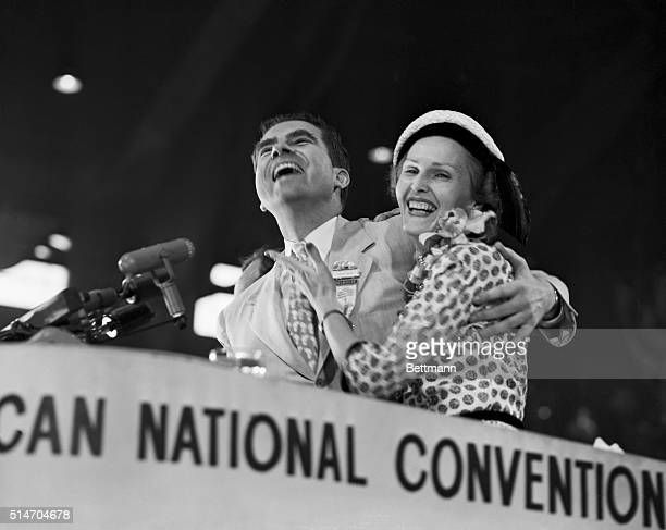 Chicago, IL: Happy duo. Flashing happy smiles, Senator and Mrs. Richard M. Nixon face a battery of cameras as they stand on the convention rostrum...