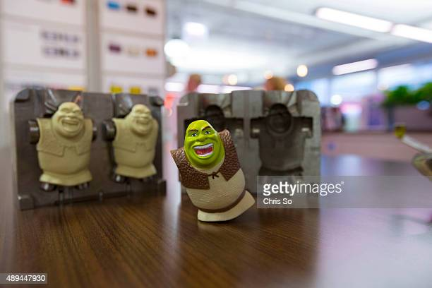 Chicago IL JULY 20 2015 The molds for a toy Shrek character at the Marketing Store in downtown Chicago The Marketing Store has been involved in...