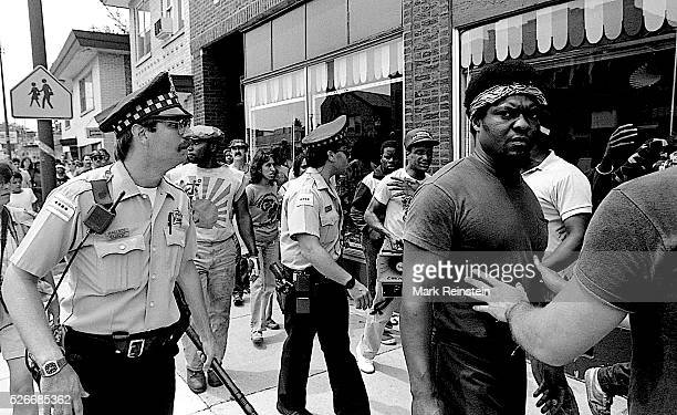 Chicago Illinois 6281986 Chicago police escort a group of black protestors along 71st in the Marquette Park area during a planned KKK rally Credit...