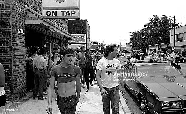 Chicago Illinois 6281986 Groups of local white jeer at a group of mixed race protestors walking thru the Marquette Park area of Chicago During a...