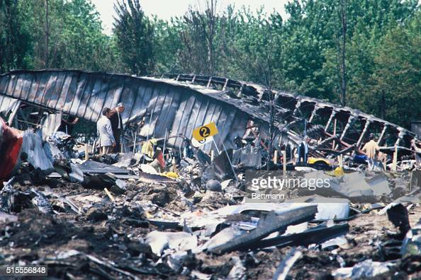 Firemen Search For Bodies In The Debris Of The American