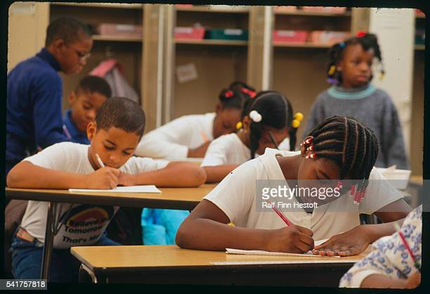 Nine and ten year old children in class while learning cursive writing and reading at the Corporate Community School