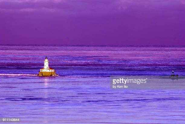chicago lighthouse in a purple evening - ken ilio stock pictures, royalty-free photos & images