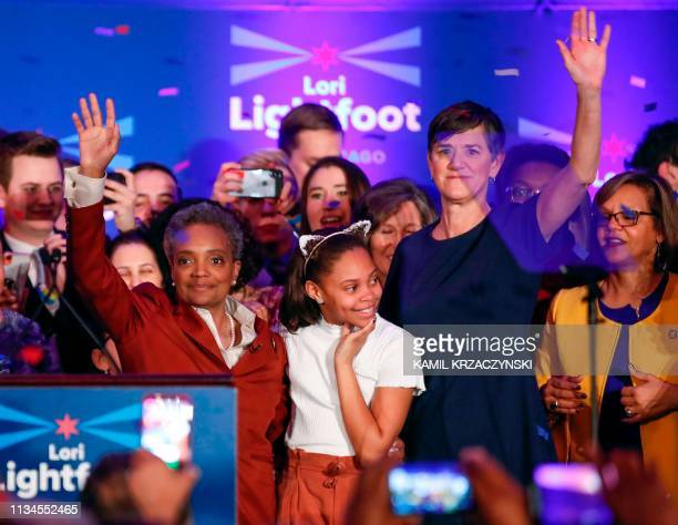 Chicago mayor elect Lori Lightfoot celebrates her victory with daughter Vivian and wife Amy Eshleman after speaking during the election night party...