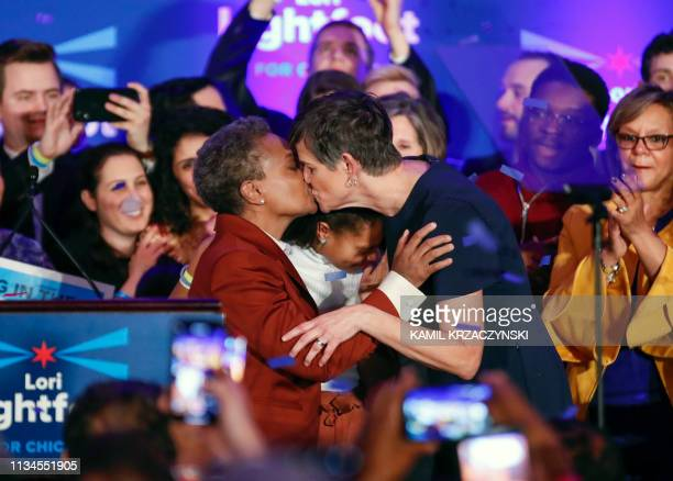 TOPSHOT Chicago mayor elect Lori Lightfoot kisses wife Amy Eshleman after speaking during the election night party in Chicago Illinois on April 2...