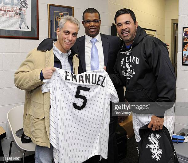 Chicago Mayor elect Rahm Emanuel displays a personalized uniform presented to him by Manager Ozzie Guillen and General Manager Ken Williams of the...
