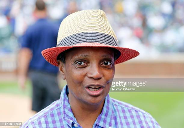 Chicago mayor Lori Lightfoot stands on the field during a ceremony honoring Lee Smith's induction into the Baseball Hall of Fame prior to a game...
