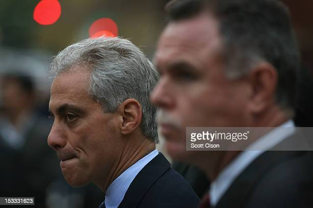 Chicago Mayor Rahm Emanuel and Police Superintendent Garry McCarthy listen to speakers before the start of an antiviolence march on October 3 2012 in...