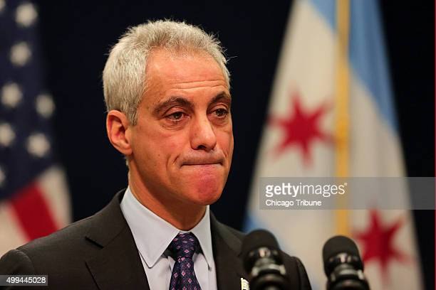Chicago Mayor Rahm Emanuel bites his lip as he listens to a question from a reporter during a press conference on Tuesday Dec 1 to announce that he...