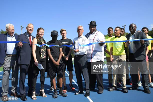 Chicago Mayor Rahm Emanuel cuts the ceremonial ribbon during the Laver Cup Legacy Court Ceremony at Garfield Park on September 17 2018 in Chicago...