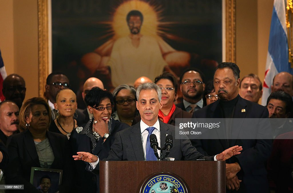 Chicago Mayor Rahm Emanuel (C), flanked by Rev. Jesse Jackson (R), speaks during a press conference with community leaders and family members of murder victims at St. Sabina Church January 3, 2013 in Chicago, Illinois. During the press conference Emanuel called for stronger gun regulations including a ban on assault weapons. In 2012 Chicago reported 506 murders. In the first 3 days of 2013 Chicago has had 5 murders.