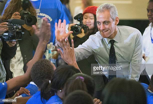 Chicago mayor Rahm Emanuel greets guests at Wendell Phillips Academy High School during a gathering to celebrate the schools state 4A football...