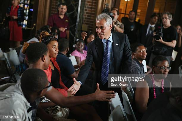 Chicago Mayor Rahm Emanuel greets residents of the 10th police district during a National Night Out event in Douglas Park on August 6 2013 in Chicago...