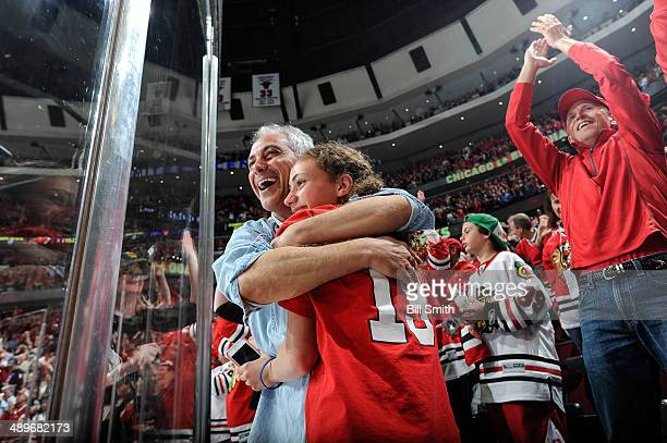 Chicago mayor Rahm Emanuel hugs his daughter Ilana after the Chicago Blackhawks scored in the third period to pull ahead of the Minnesota Wild in...