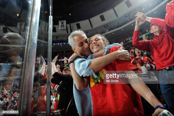 Chicago mayor Rahm Emanuel hugs his daughter Ilana after the Chicago Blackhawks defeated the Minnesota Wild 21 in Game Five of the Second Round of...