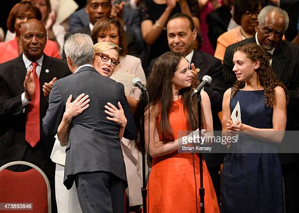 Chicago Mayor Rahm Emanuel hugs his wife Amy Rule as he stands on stage with daughters Leah and Ilana after taking the oath of office as he is...